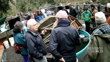 Bill Hagen tells one more fish story at the March 17, 2015 Chum salmon fry release at the Imprint Pond on Venema Creek, Carkeek Park.